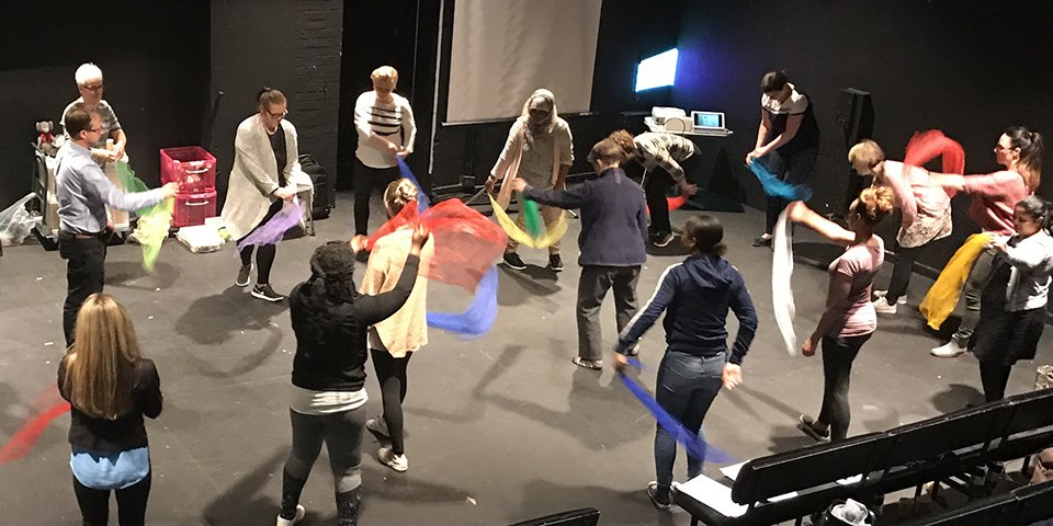 Header photo: Exploring movement with scarves at a Tri-Music Together event