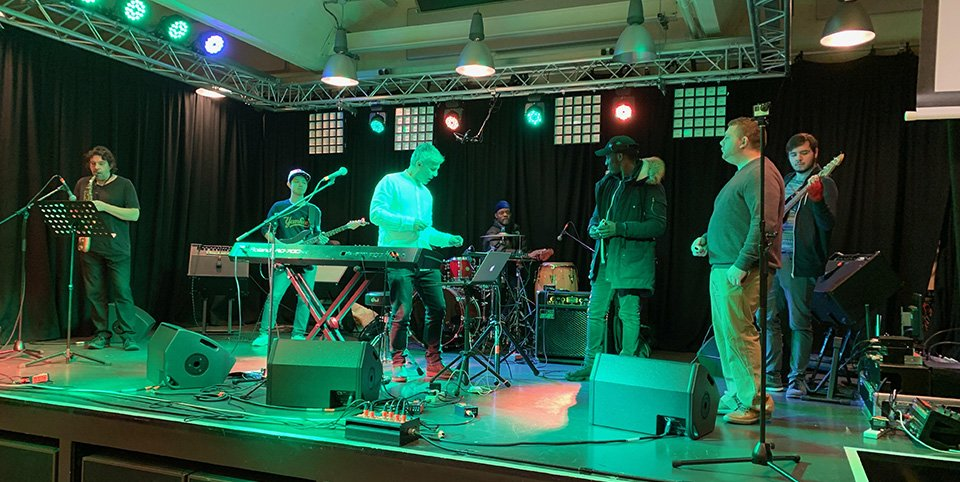 Interactive Musical Participation in action – the band on stage during the Harrow showcase