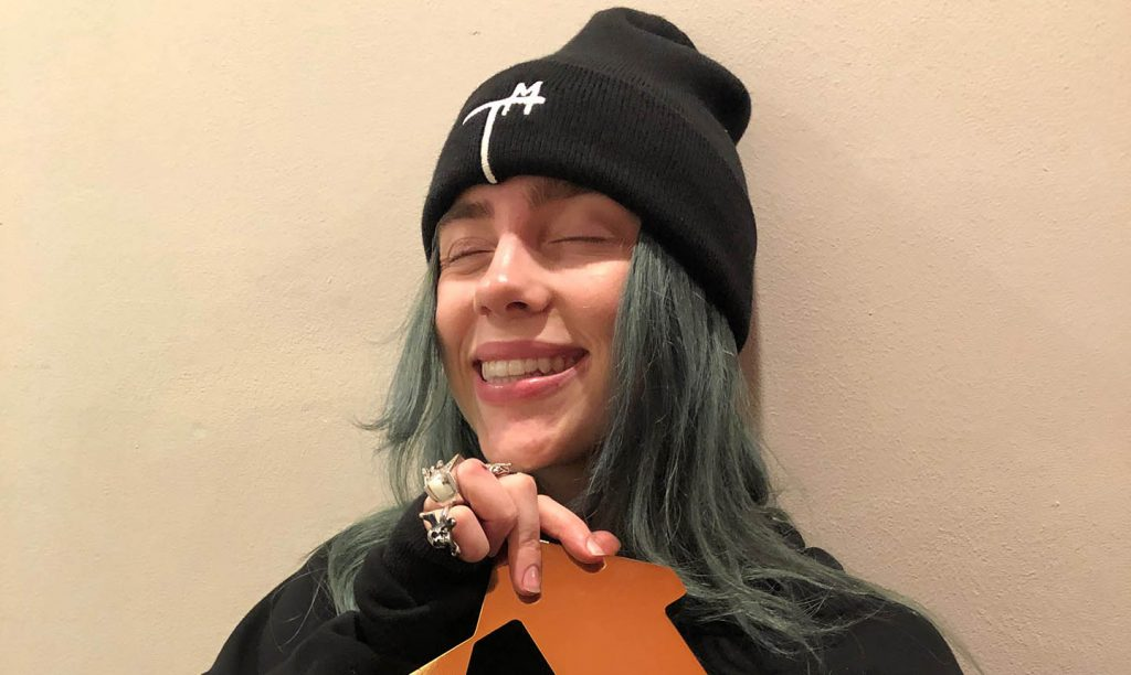 Billie Eilish with her Official Number 1 Album Award for 'When We All Fall Asleep, Where Do We Go?' © Official Charts