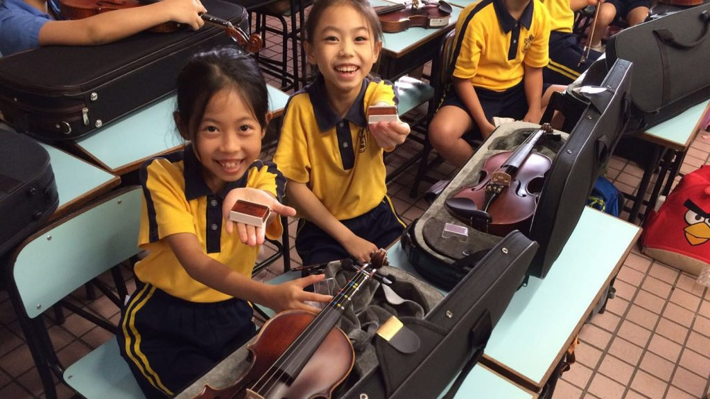 Young string players from Hong Kong String Orchestra's 'Light of Hope' music training programme