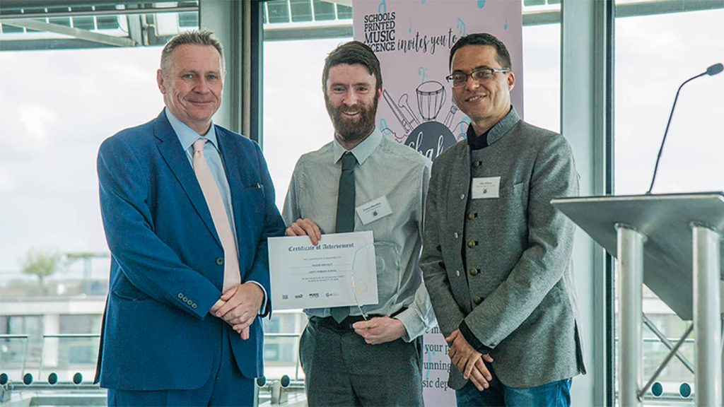 Winner of the 2019 Shake It Up! Award, Frazer Hinchley (centre) with Lord Black of Brentwood (l) and Alex Wilson (r)