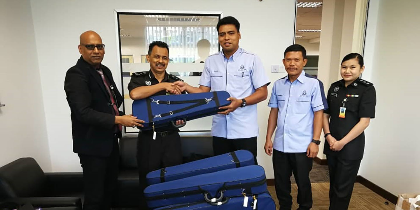 Handing over the first batch of violins to the Malaysian Prison Department