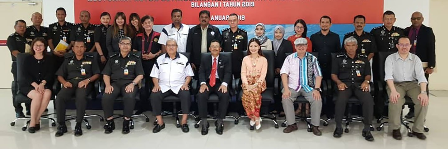 Peter Chua (third from right, front row) and the Rhythm of Freedom team giving a Project Presentation to the Director General of the Malaysian Prison Department