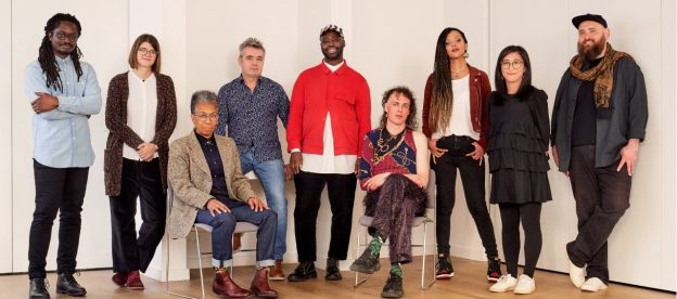 Recipients of PHF Awards for Artists 2019. L to r: Larry Achiampong, Laura Jurd, Ingrid Pollard, Mark Lockheart, Harold Offeh, Adam Christensen‎, Phoebe Boswell, Shiori Usui, Nathaniel Mann (Eleanor Alberga on tour in China). Photo Credit: Emile Holba