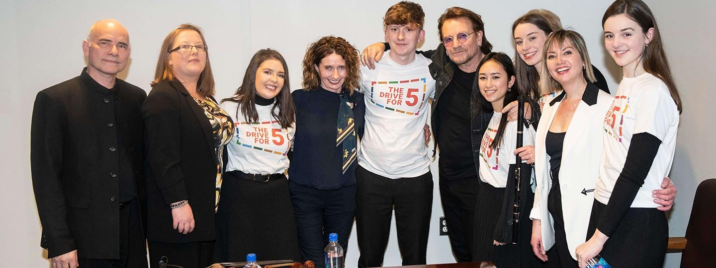 Pictured with Bono, Music Generation Young Ambassadors perform at the Irish Government's launch of The Drive For Five © Kim Haughton