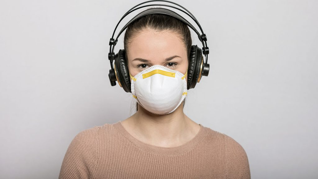 Masked woman with headphones