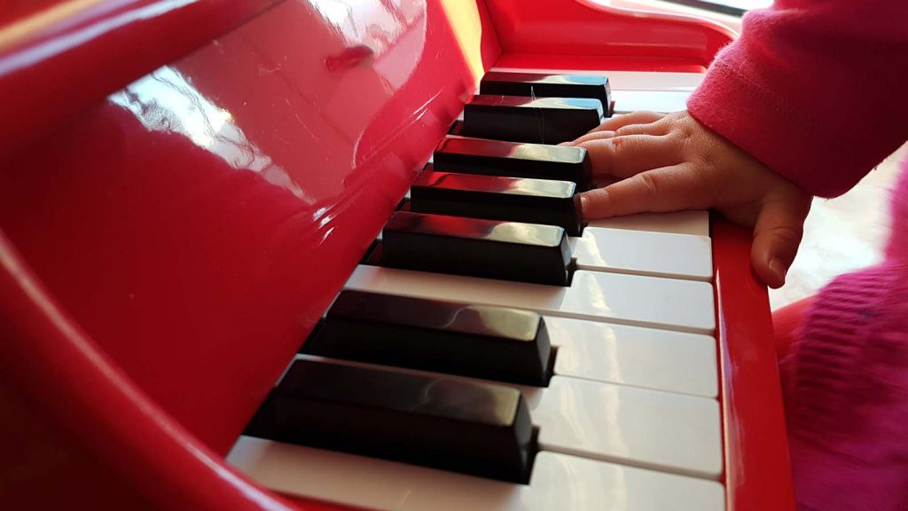 Infant at red keyboard