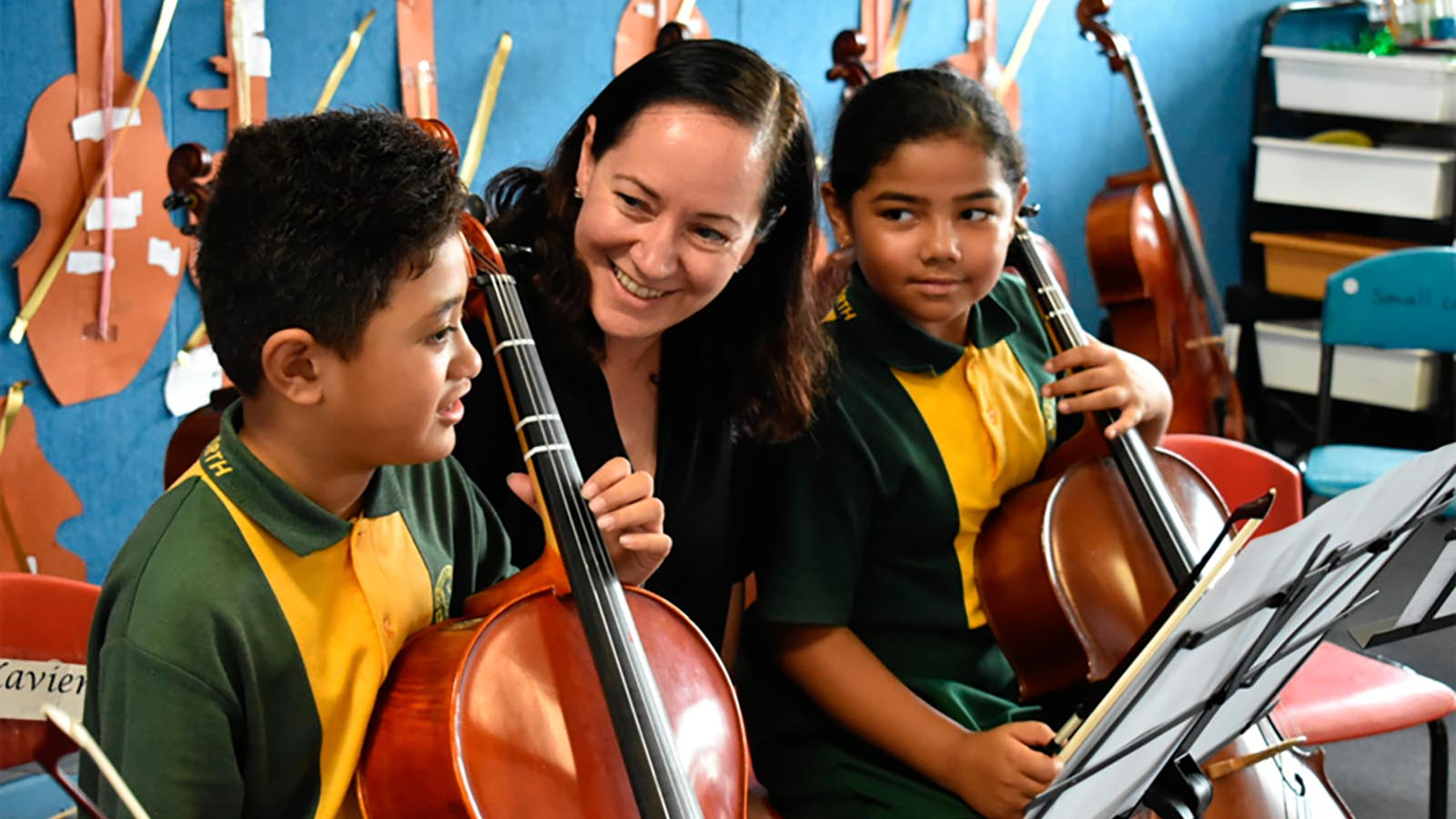 Dr Anita Collins with young musicians