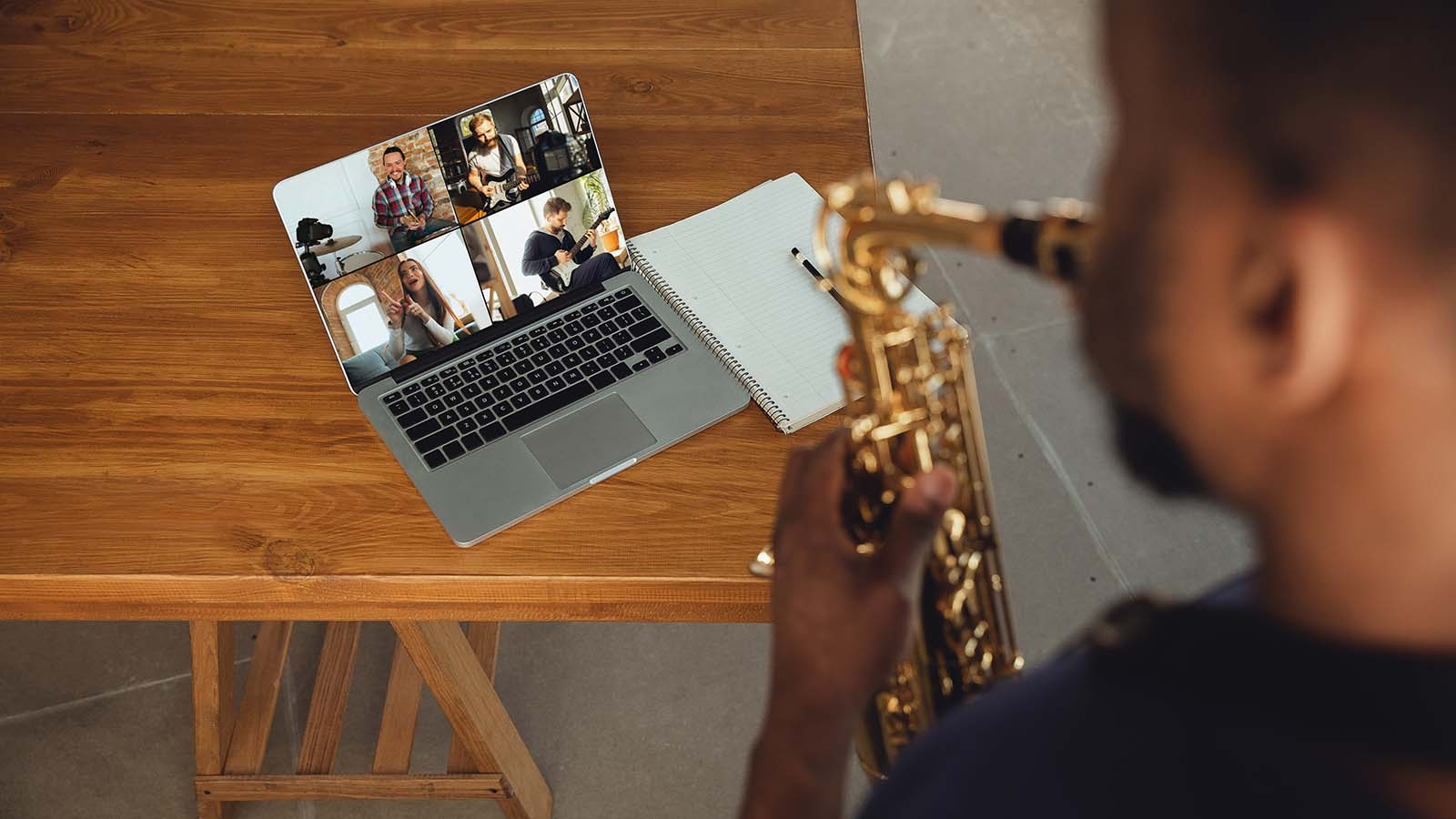 Saxophonist playing online with other musicians