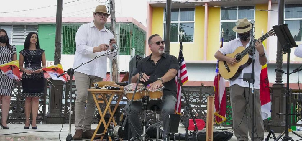 Dr Miguel Cardona playing bombas. Photo © US Department of Education